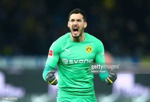 Roman Buerki of Borussia Dortmund celebrates after Marco Reus of Borussia Dortmund scores his team's third goal during the Bundesliga match between...