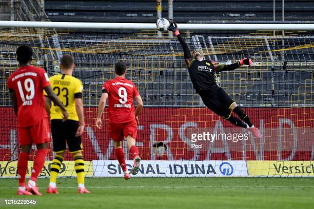 Roman Buerki of Borussia Dortmund fails to stop the shot of Joshua Kimmich of Bayern Munich for Bayern Munich's first goal during the Bundesliga...