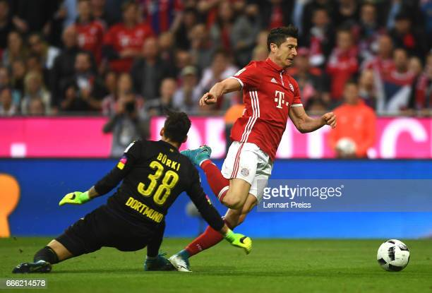Roman Buerki of Borussia Dortmund fouls Robert Lewandowski of Bayern Muenchen for a penalty during the Bundesliga match between Bayern Muenchen and...