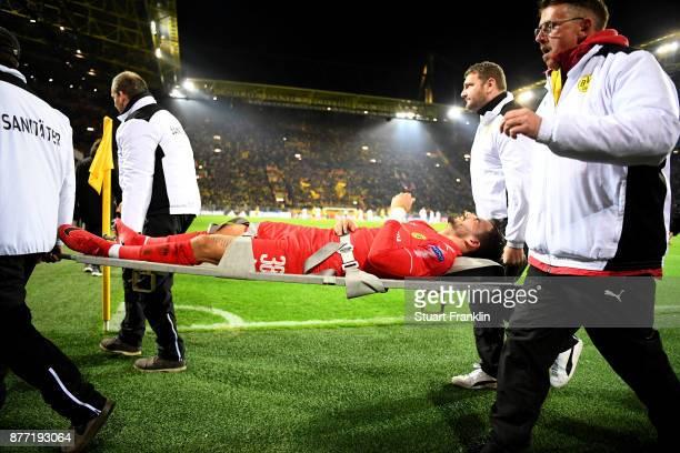 Roman Buerki of Borussia Dortmund is stretchered off during the UEFA Champions League group H match between Borussia Dortmund and Tottenham Hotspur...