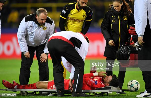 Roman Buerki of Borussia Dortmund receives treatment from the medical team during the UEFA Champions League group H match between Borussia Dortmund...