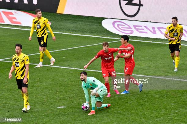 Roman Buerki of Borussia Dortmund rolls the ball out during the Bundesliga match between Borussia Dortmund and RB Leipzig at Signal Iduna Park on May...