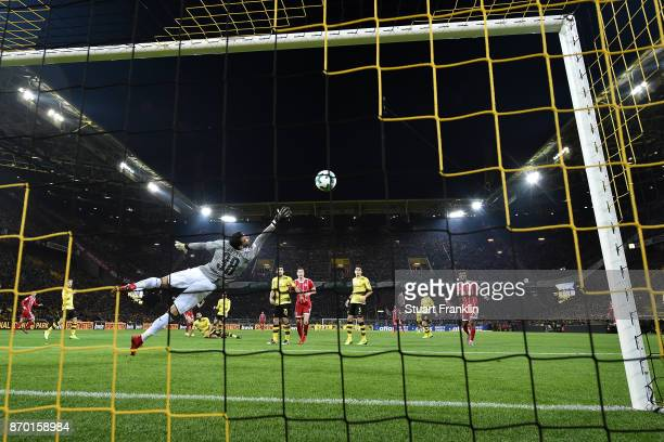 Roman Buerki of Dortmund can't safe a shot by Arjen Robben of Bayern Muenchen who shoes the first goal to make it 01 during the Bundesliga match...