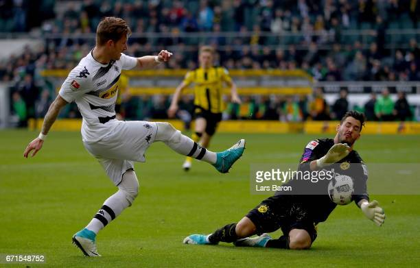Roman Buerki of Dortmund saves a shot of Andre Hahn of Moenchengladbach during the Bundesliga match between Borussia Moenchengladbach and Borussia...