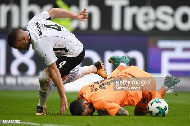 Roman Buerki of Dortmund saves against Ante Rebic of Frankfurt during the Bundesliga match between Eintracht Frankfurt and Borussia Dortmund at...