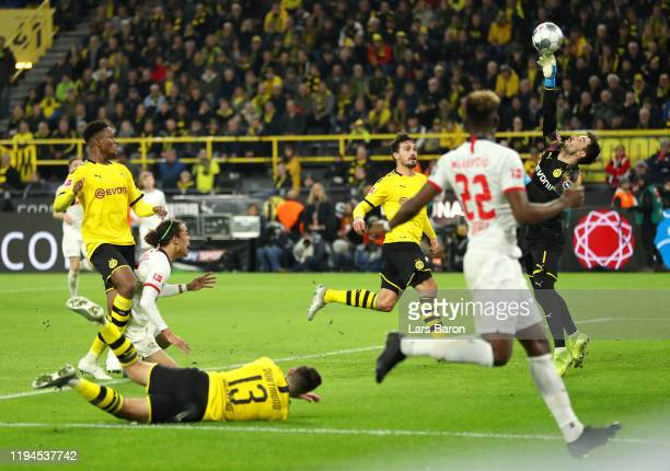 Roman Burki of Borussia Dortmund makes a save from Yussuf Poulsen of RB Leipzig during the Bundesliga match between Borussia Dortmund and RB Leipzig...