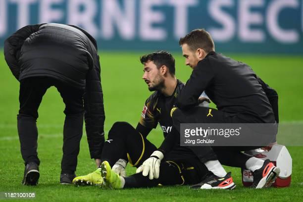 Roman Burki of Borussia Dortmund receives medical treatment during the Bundesliga match between Borussia Dortmund and Borussia Moenchengladbach at...