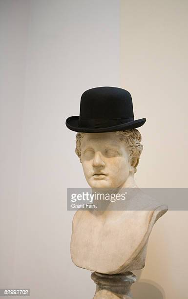 roman bust with bowler hat