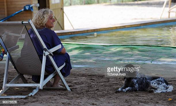 Roman canines beat dog days of summer Dogs and their owners relax at a beach for dogs on the Tiber river in Rome on August 24 2009 While dogs are...