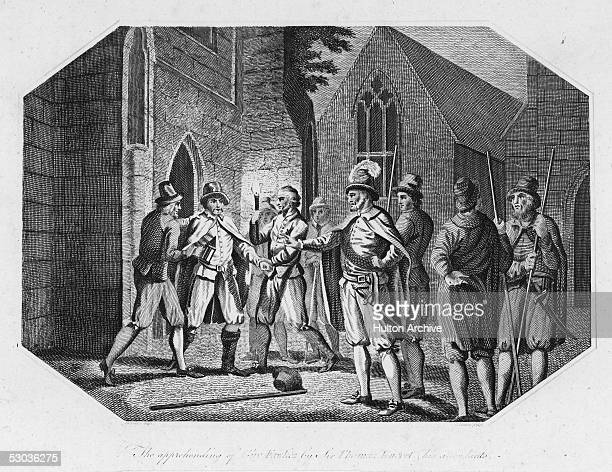 Roman Catholic conspirator Guy Fawkes is arrested by Sir Thomas Knevytt and his men in a cellar underneath Parliament 5th November 1605 Fawkes was...