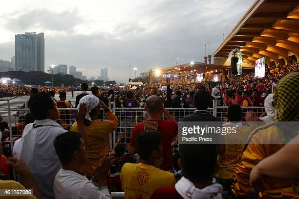 Roman Catholic devotees attend the dawn mass before the Black Nazarene starts its holy procession from the Quirino Grandstand believing some miracles...