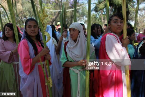 Roman Catholic devotes During Palm Sunday Palm fronds are waved to be blessed by a priest to commemorate Palm Sunday which marks the beginning of...