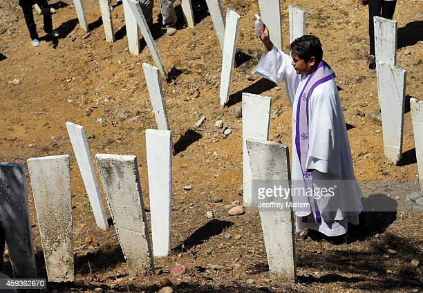 Roman Catholic priest blesses the site where five years ago 58 people 32 of them journalists were killed by members of a powerful Muslim clan on...