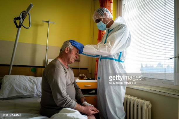 Roman Catholic priest Martin Miskuf blesses a Covid-19 patient hospitalised at Covid-19 ward at University Hospital J.A. Reiman in Presov, Slovakia...