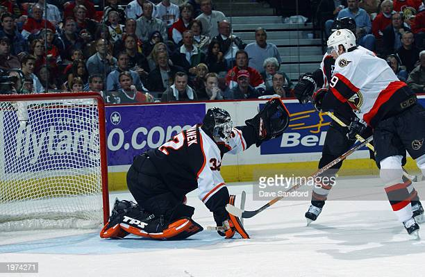 Roman Cechmanek of the Philadelphia Flyers makes a glove save on Martin Havlat of the Ottawa Senators in Game two of the Eastern Conference...
