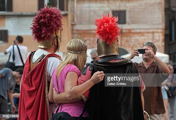 Roman centurions pose with tourists, Rome, Italy