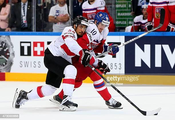 Roman Cervenka of Czech Republic and Eric BLum of Switzerland battle for the puck during the IIHF World Championship group A match between Czech...
