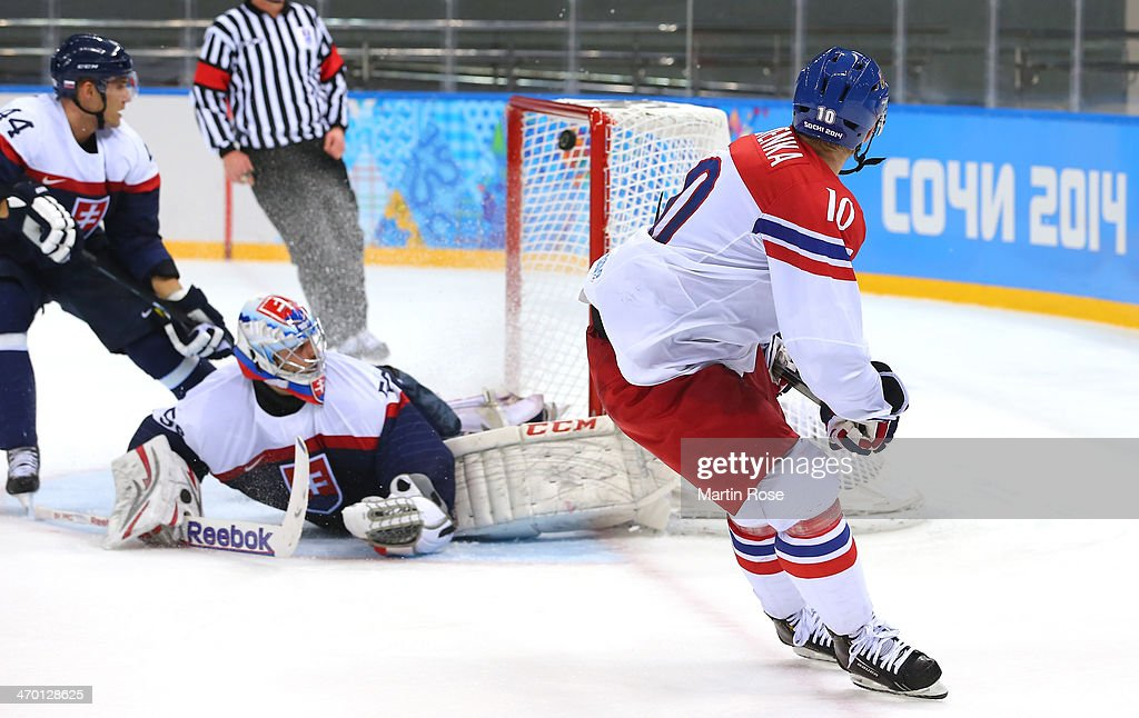 Roman Cervenka #10 of Czech Republic shoots and scores against Jan Laco #50 of Slovakia in the second period during the Men's Qualification Playoff Game on day 11 of the Sochi 2014 Winter Olympics at Shayba Arena on February 18, 2014 in Sochi, Russia.