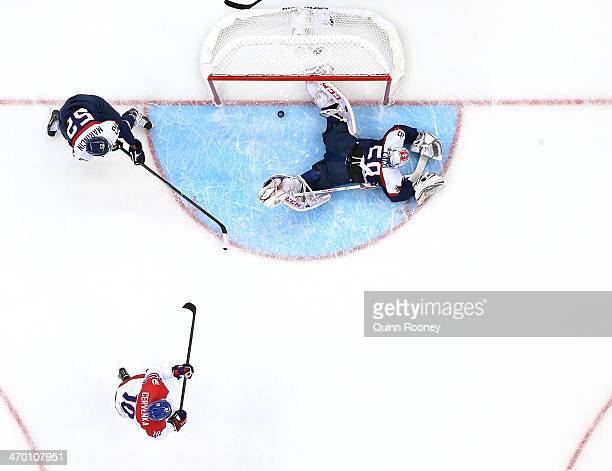 Roman Cervenka of Czech Republic shoots and scores in the first period against Jan Laco of Slovakia during the Men's Qualification Playoff Game on...