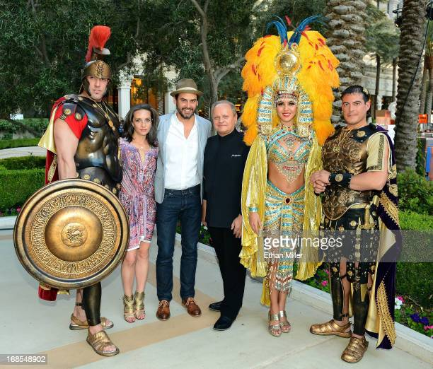 Roman characters pose with Vice President and Publisher of Bon Appetit magazine Pamela Drucker Mann Bon Appetit magazine restaurant and spirits...