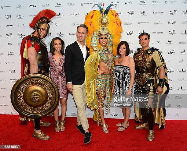 Roman characters pose with Vice President and Publisher of Bon Appetit magazine Pamela Drucker Mann EditorinChief of Bon Appetit magazine Adam...