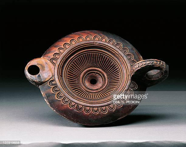Roman civilization 1st century AD Decorated clay oil lamp painted with brownreddish colors From Pompei