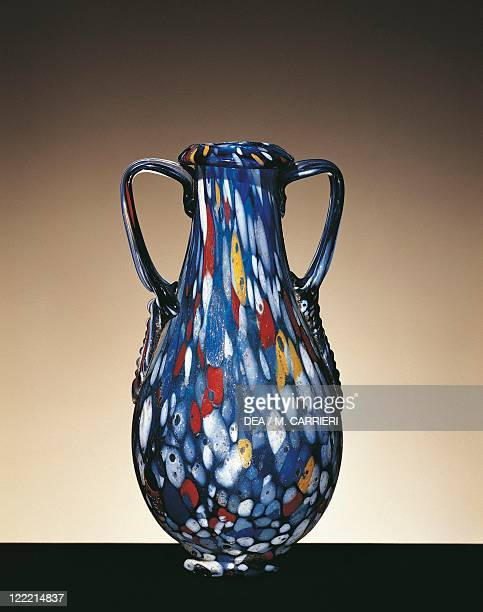 Roman civilization 1st century AD Glassware Two handled vase of blue blown glass decorated with white yellow and red dots From Lebanon