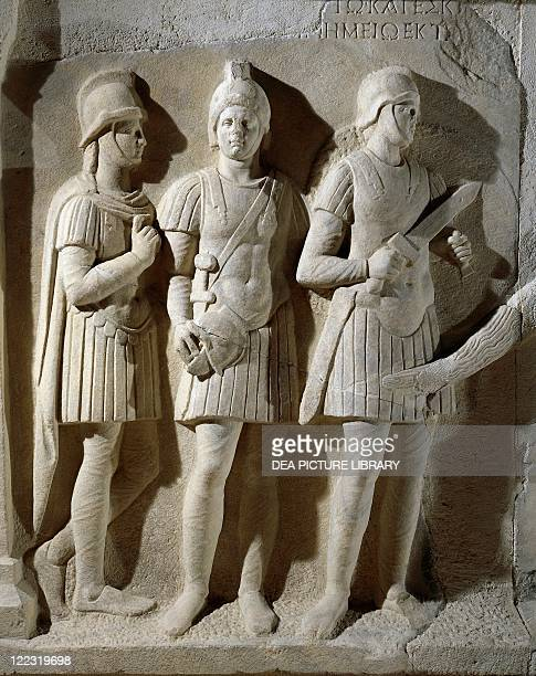 Roman civilization 1st century bC Marble sarcophagus of the prefect Tiberius Flavius Miccalus From Kamaradere Detail three soldiers of the escort
