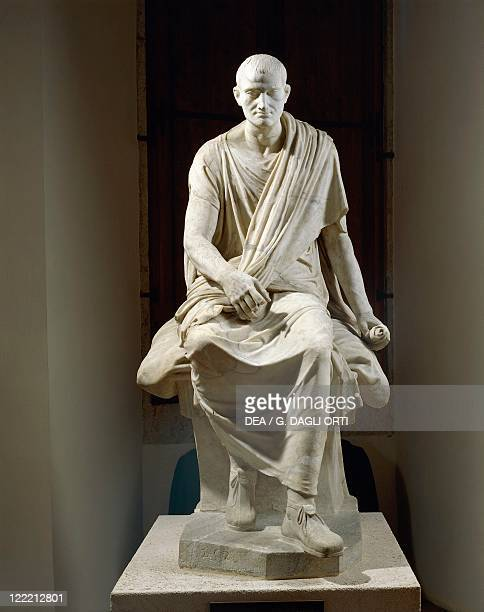 Roman civilization 1st century bC Marble statue of a seated togaed man