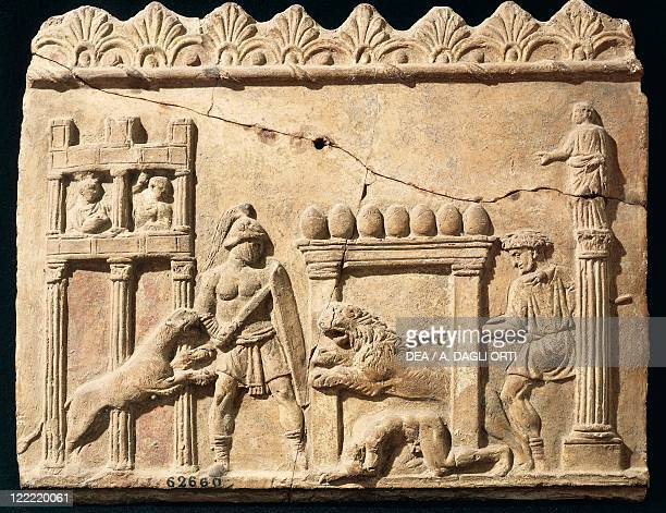 Roman civilization 1st century bC Terracotta relief depicting lions and gladiators fighting in the circus