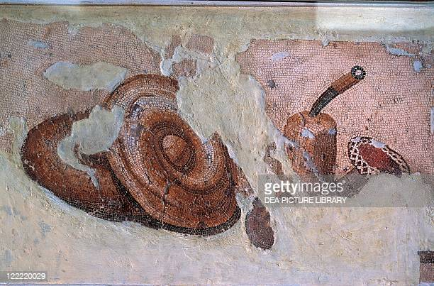 Roman civilization 2nd century AD Detail of mosaic depicting two bread loaves and a piece of butter with a knife stuck into it From Oudna ancient...