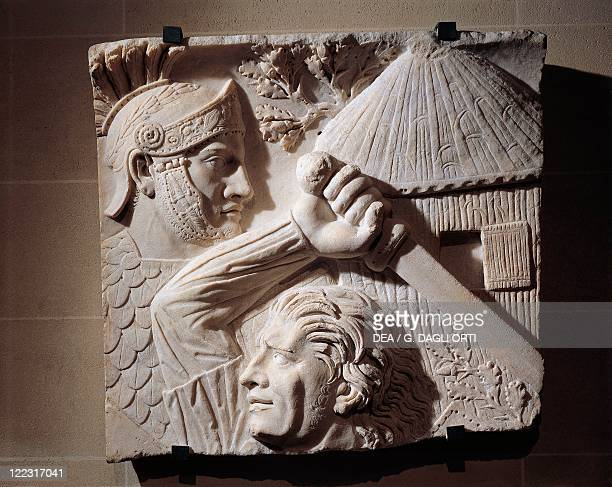 Roman civilization 2nd century AD Marble relief representing a Barbarian fighting against a Roman From Rome Trajan's Forum