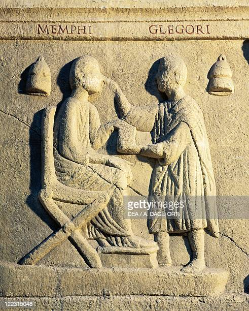 Roman civilization 2nd century AD Relief portraying an ophthalmologist examining a patient