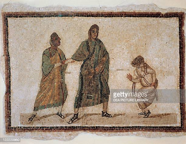 Roman civilization 3rd century AD Detail of mosaic depicting a scene of a comedy a slave chained by his master who receives a messenger From ancient...