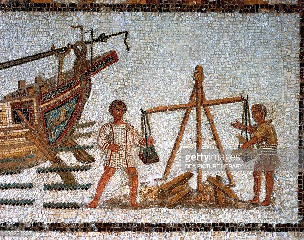 Roman civilization 3rd century AD Mosaic depicting unloading of a ship carrying iron minerals From Hadrumetum Sousse Tunisia Detail weighing of the...