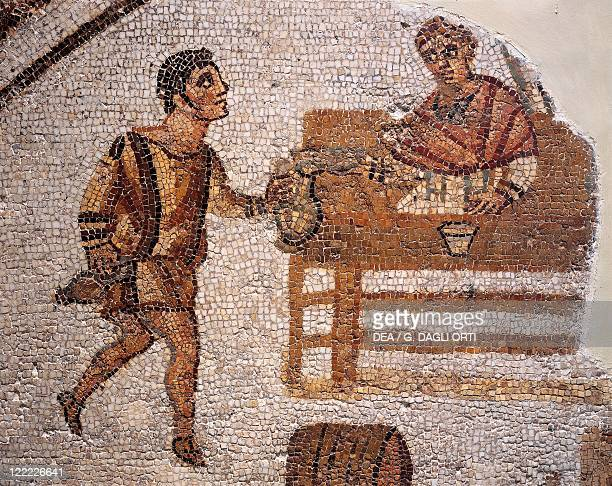 Roman civilization 4th century AD Mosaic depicting a banquet at Carthage From Uzitta Henchir El Machceba Tunisia Detail a servant pouring a drink to...