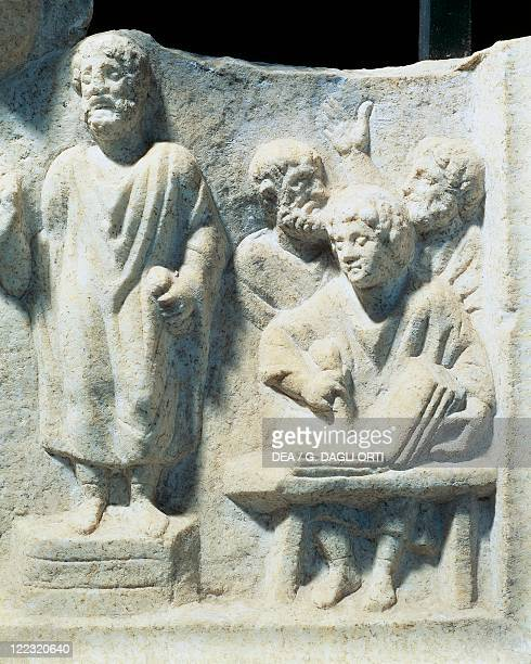 Roman civilization 4th century Relief depicting an orator dictating to a scribe From the Temple of Hercules at Ostia Antica