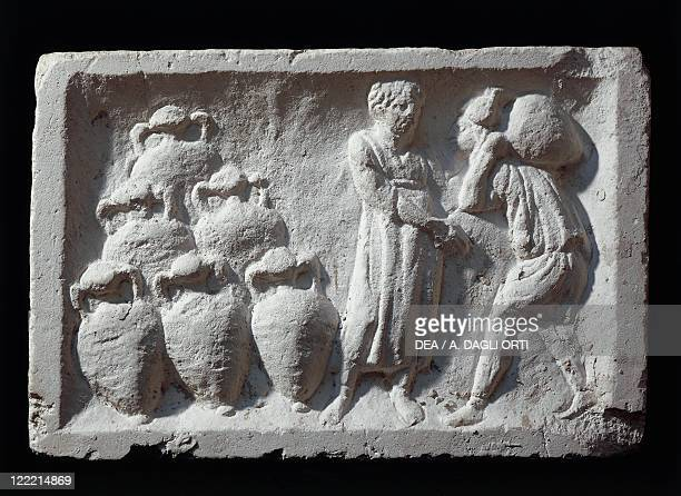 Roman civilization Basrelief depicting a Roman cellar with amphorae wine ware