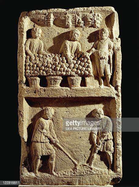 Roman civilization Pillar of the Farmer fruit market and two peasants working the land From France