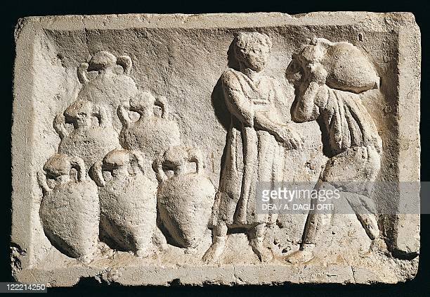 Roman civilization Relief depicting people carrying amphorae in a wine cellar