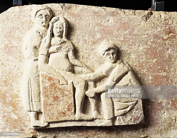 Roman civilization Relief depicting scene of a childbirth From the tomb of Scribonia Attica at the necropolis of Isola Sacra Rome