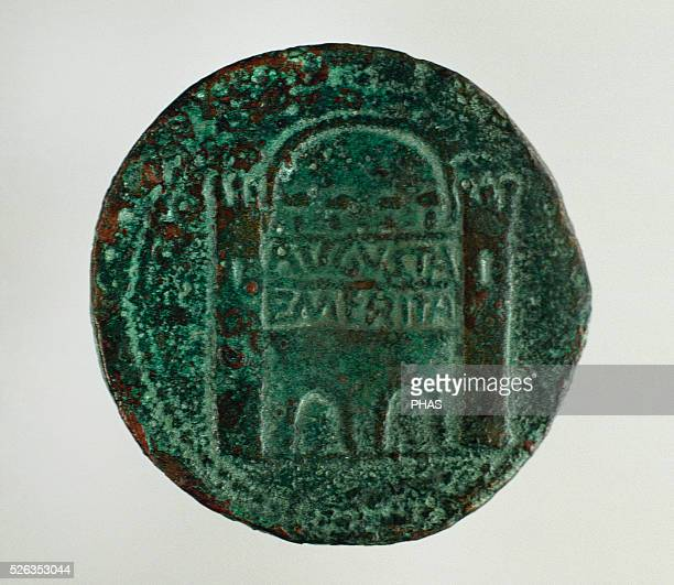 Roman coin Dupondius Reverse Relief depicting the gate of the wall of Augusta Emerita Brass 1st century BC National Museum of Roman Art Merida Spain