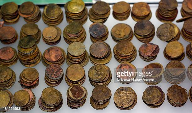 Roman coins from the spring in the Roman Baths England Dating from 2nd century BC to 2nd century AD