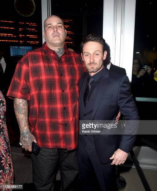 Roman Coleman and Josh Stewart arrive at the premiere of Focus Features' The Mustang at ArcLight Hollywood on March 12 2019 in Hollywood California