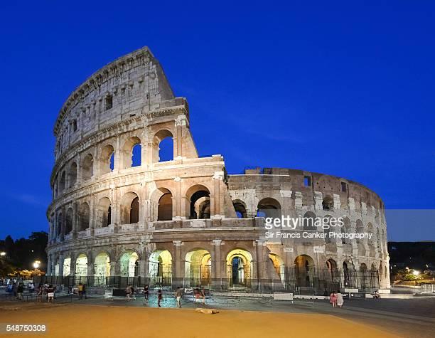 Roman Colosseum (Flavian Amphitheater) illuminated at night in Rome, Italy