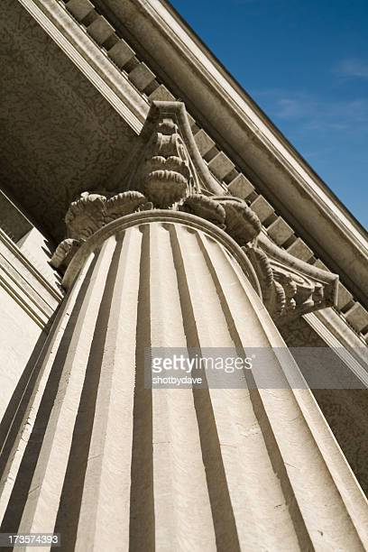roman column on wall street - column stock pictures, royalty-free photos & images