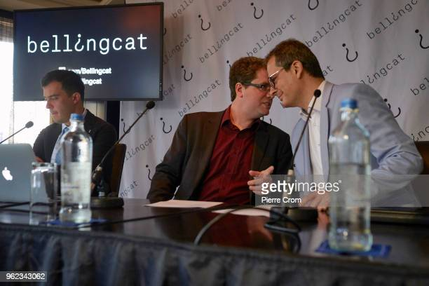 Roman Dobrokhotov from The Insider Eliot Higgins and Moritz Rakuszitzky from the citizen journalist's organisation Bellingcat are portrayed during a...