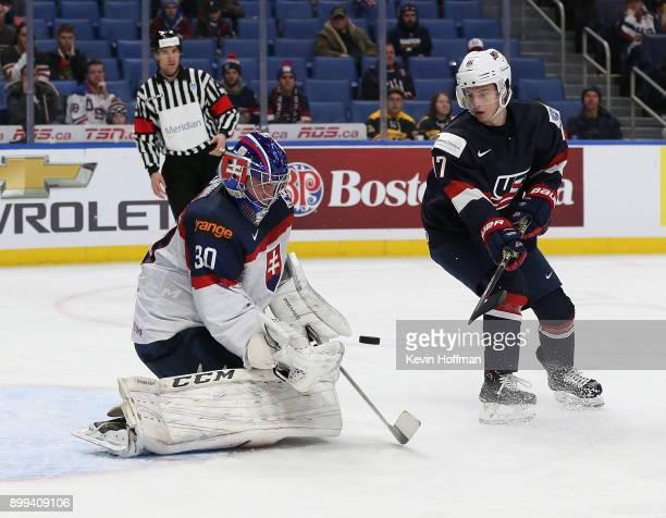 Roman Durny of Slovakia makes the save against Kailer Yamamoto of United States in the second period during the IIHF World Junior Championship at...