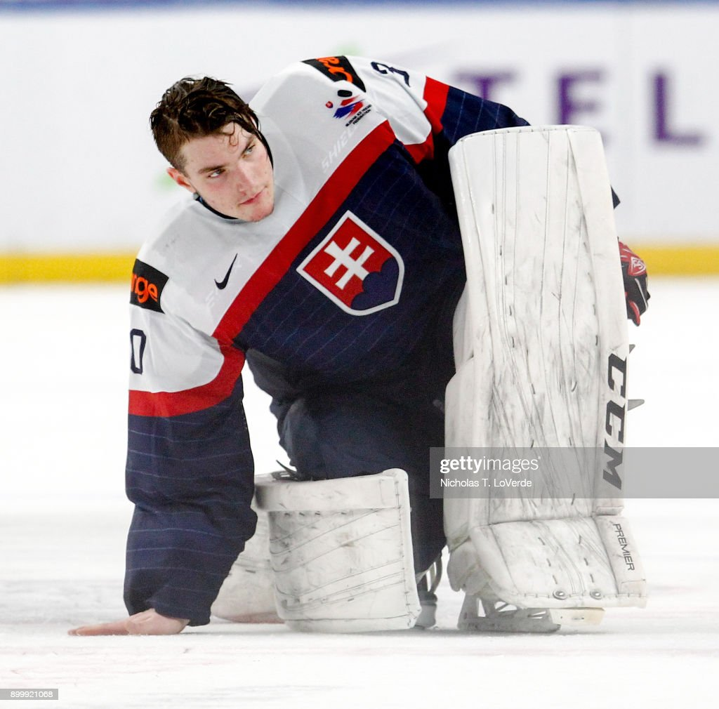 Roman Durny #30 of Slovakia swipes his hand on the ice prior to exiting the arena following a 5-2 loss to Finland in the IIHF World Junior Championships at the KeyBank Center on December 30, 2017 in Buffalo, New York.