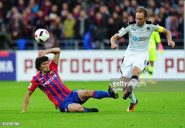 Roman Eremenko of PFC CSKA Moscow vies for the ball with Andreas Granqvist of FC Krasnodar Krasnodar during the Russian Premier League match between...